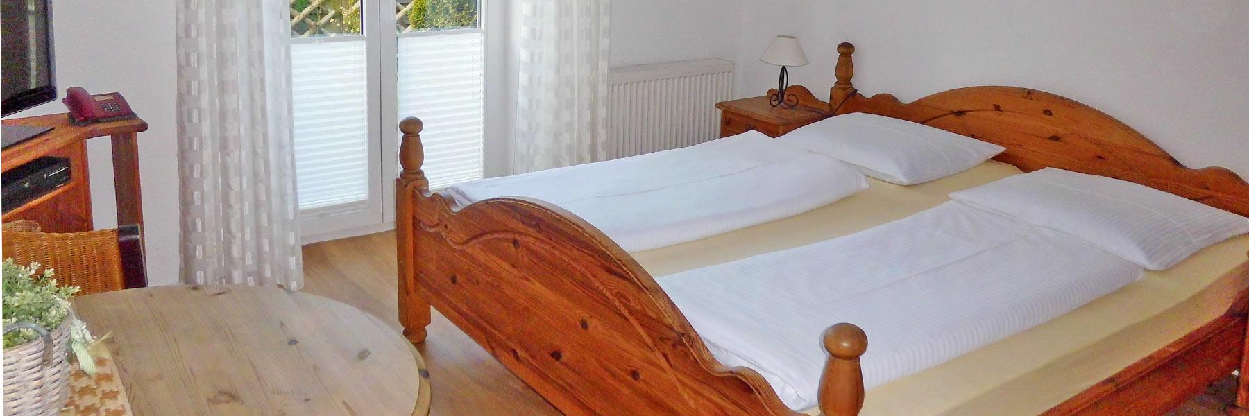 """Schlafzimmer - Ferienappartements """"Zwischen Meer und Bodden"""""""