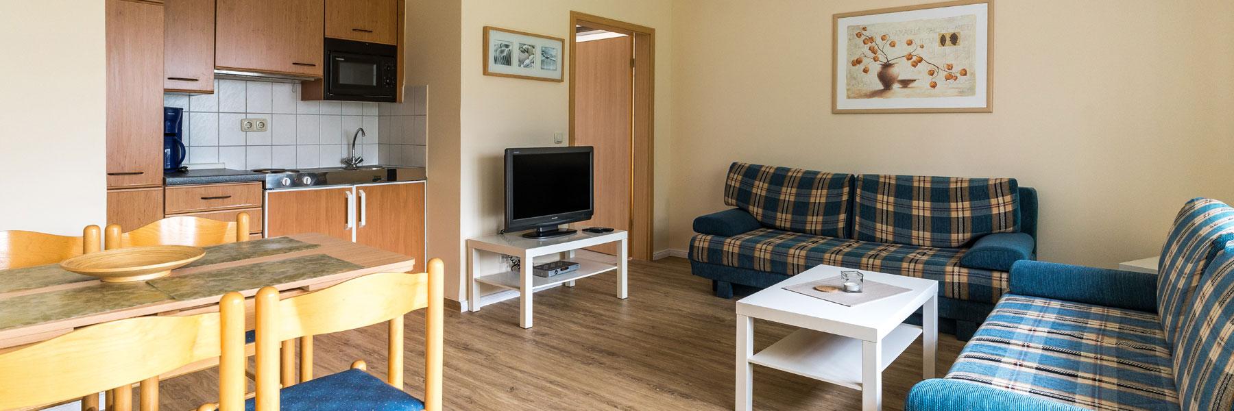 Ferienwohnung mit Küche und Couch - Gästehaus Bade