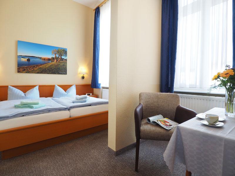 Appartements mit Doppelbett und Sitzecke