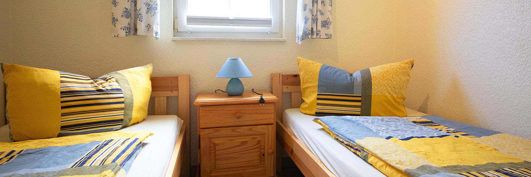 Schlafzimmer - Ferienwohnungen Giese