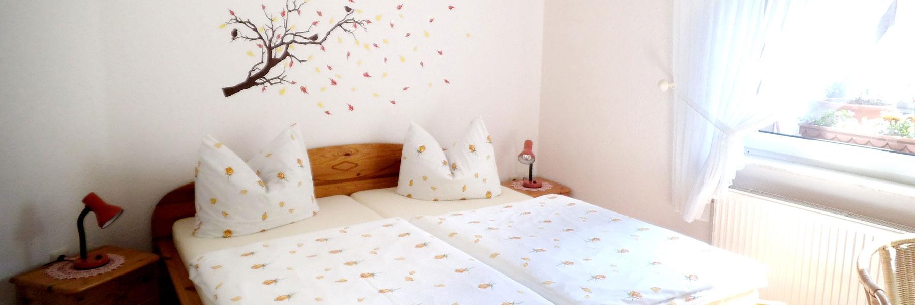Schlafzimmer - Ferienwohnung Hahn