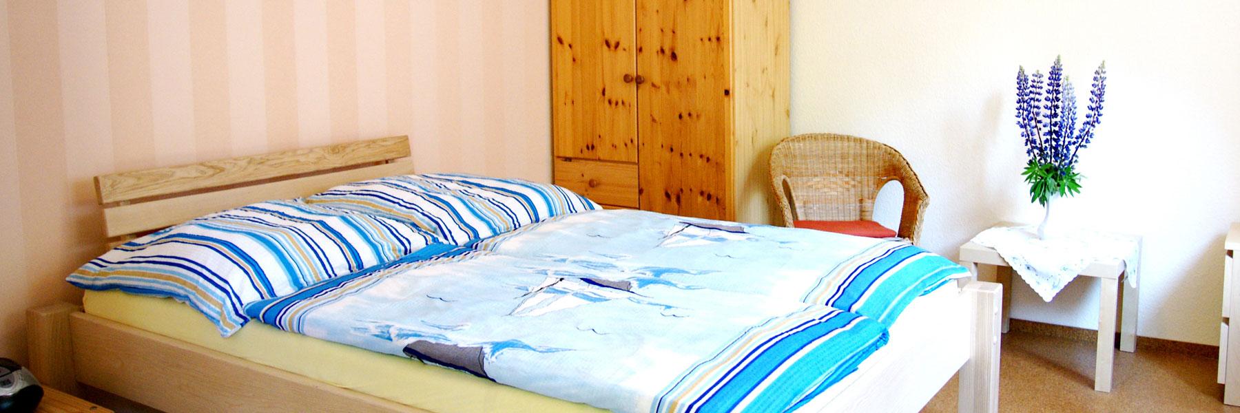 Schlafzimmer - Ferienwohnung Lubmin