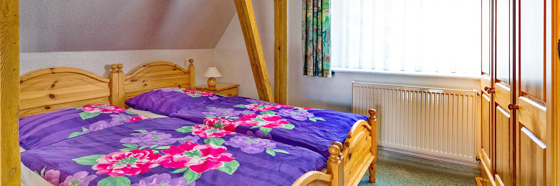 Schlafzimmer - Ferienwohnungen Waldesruh Dierhagen