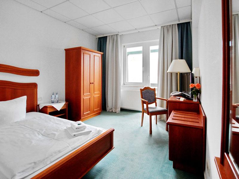 Einzelzimmer mit Doppelbett